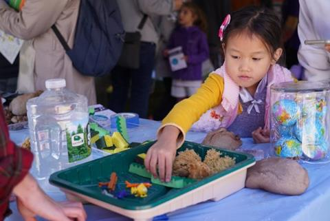 Kids learn how wetlands and other natural obstacles can help prevent flooding and storm surges in coastal areas (Kyu Lee)
