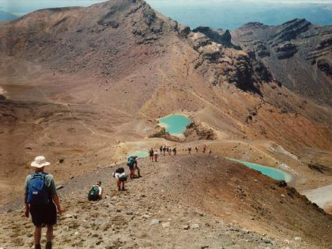 walking the Tongariro Crossing, with Emerald Lakes and Mount Tongariro in the distance Tongariro National Park. Photo credit: Jimmy Johnson DOC