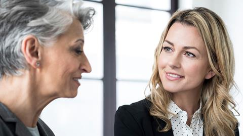 image of two women in an office environment