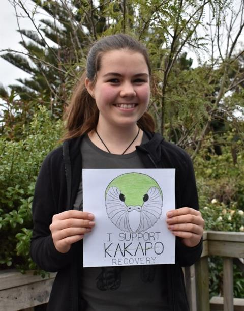 Te Huia with her winning kākāpō tshirt design