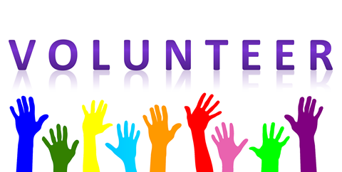 "The is a photo of multi-coloured hands raised with the words ""Volunteer"" above it."