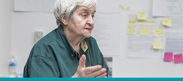 Older woman giving input during a quality improvement planning meeting