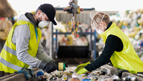 Workers at a recycling plant
