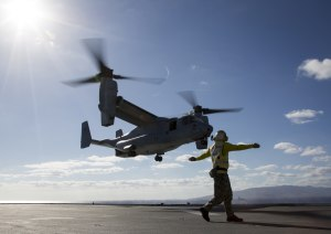 Leading Seaman Aviation Support Jamie Kennedy signals to a US Marine V-22 Osprey. Defence