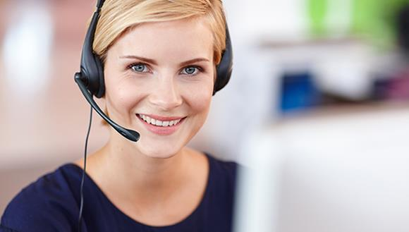 Women with headset at computer