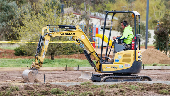 Digger working in park.