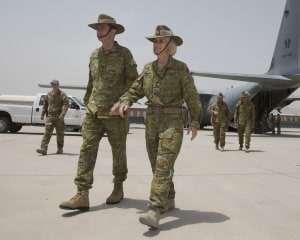 CDF General Angus Campbell walks with Brigadier Cheryl Pearce in Kabul during her time as Commander Task Group Afghanistan. Defence