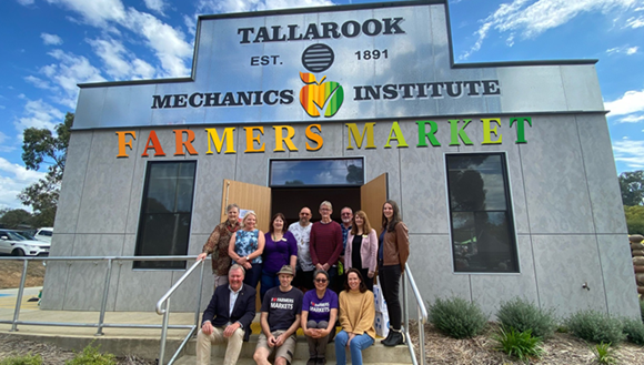 Group on the steps of the hall at Tallarook Farmers Market