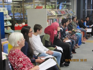 Adrienne Jansen, Carina Gallegos and ESOL students from Mana and Aotea Colleges read poems at My Name is not Refugee, an event at the Porirua Library in April 2018