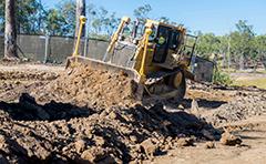Machinery moving soil