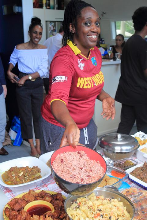 President of the West Indian and Caribbean community Matesha Ababa shows off the classic food of the Caribbean: rice and beans. Photo credit: Everall Dean