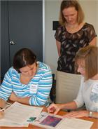 Dr. Rebecca Fry engages in a discussion with two participants in the August 12 Epigenetics workshop.