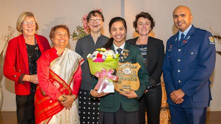 Image of Kimberly D'Mello of Aquinas College, Tauranga, who won the competition in May 2015, photographed with the judging panel.