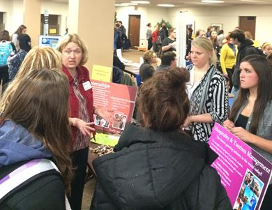 Prof. Allison Adams and current students speak with prospective students