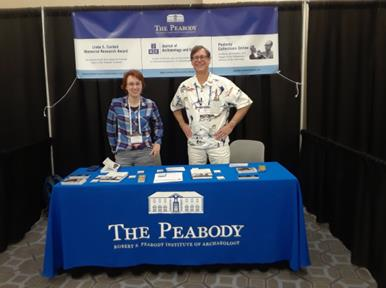 Director, Ryan Wheeler, and Assistant Curator, Rachel Manning standing with the Peabody booth at the Society for American Archaeology annual meeting.