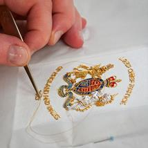 Working the Royal Arms on gloves for the new Lord Chief Justice