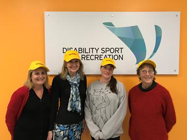 Four women wearing fire warden hats