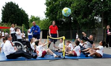 Coach in a session with disabled children