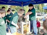 scouts making cider at the Cedar Mill Festival
