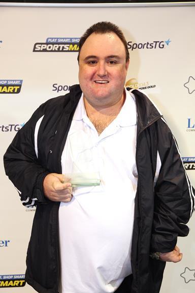 Ben Peacock holding an award
