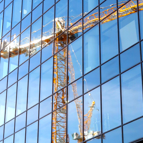 Crane reflected in office windows Cooke & Arkwright