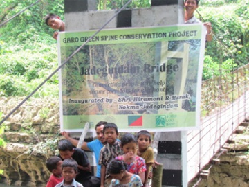 Children and a WTI Field Officer at the opening ceremony for the hanging bridge. ©  WTI.