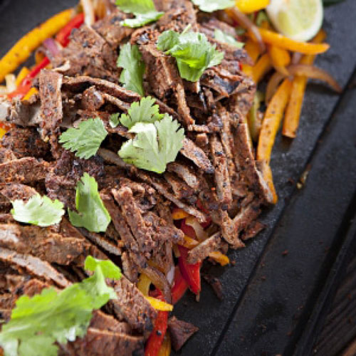 Beef fajitas on a grill