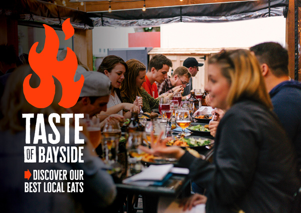 Taste of Bayside logo with people eating at a long table