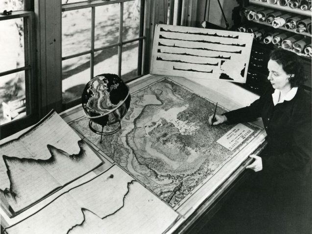 Marie Tharp with one of her maps. Image: Lamont-Doherty Earth Observatory and the estate of Marie Tharp