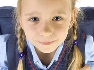 Young girl in school uniform