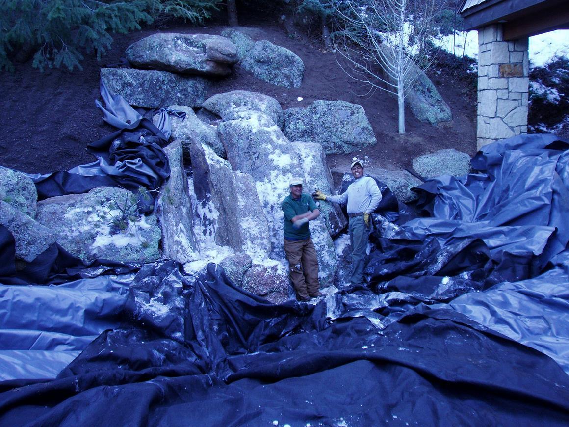 A scale image of a garden boulder