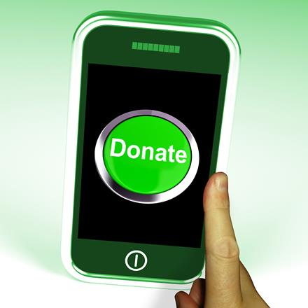 Smartphone with a green button to donate on screen