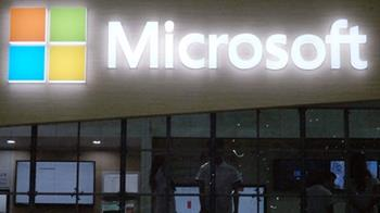 Microsoft market cap tops $1 trillion as stock surges to record high