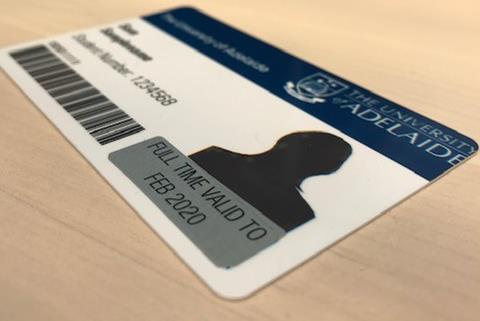 Image of sample student ID card on a wooden surface.