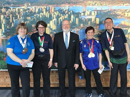 New Car Dealers Association Chair with Special Olympics athletes