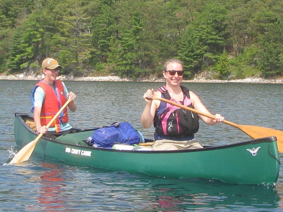 Boy and girl canoeing