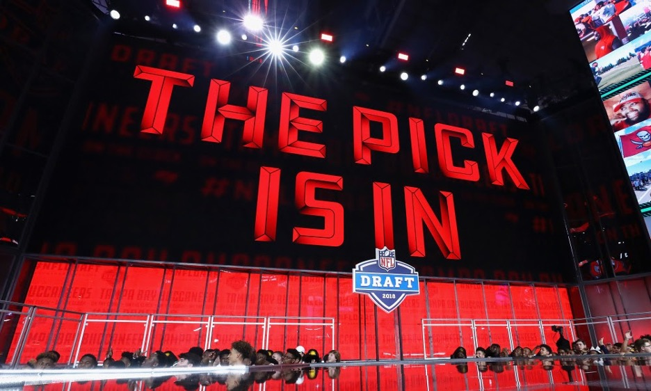 """NFL Draft stage with """"The Pick Is In"""" sign"""